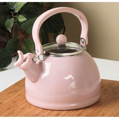 A charming, pastel pink colors the porcelain of this Calypso Basics tea kettle. Every well-stocked kitchen needs the comfort of a whistling kettle.