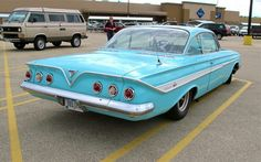 1961 Chevy Impala 235ci 6cyl. removed and I installed a 283ci V-8 3spd stick on the floor