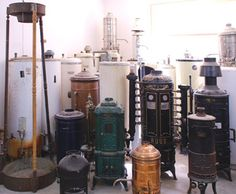 Antique hot water tanks | An array of old hot water heaters