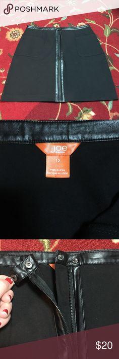Funky Joe Fresh Skirt - Size 12 Funky Joe Fresh Skirt - Size 12. The skirt is 67% Viscose, 29% Nylon, 4% Elastane with a trim made of Polyurethane. Skirt has functional front zipper and snap closure. Length is 19 1/2 inches Joe Fresh Skirts