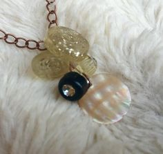 Sparkle Shell Vintage Button Necklace by NeverDoubtDesigns
