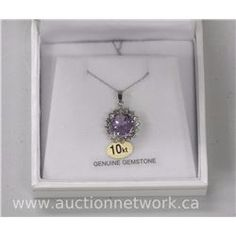 Ladies 10kt Gold Amethyst and Green Sapphire Pendant with Chain. (14) MSRP $1,200.00 - Auction Network