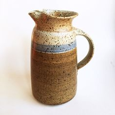 A personal favorite from my Etsy shop https://www.etsy.com/listing/468617489/vintage-studio-pottery-striped-pitcher
