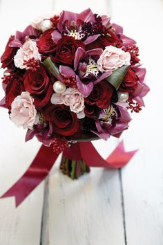Red hand tied wedding bouquet, made by Tara Calson, Sweet Peas' Floral.