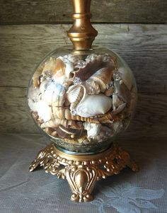 This is much more interesting than the urn lamp bases filled with shells. Recycled Vintage Nautical Sea Shell Lamp