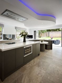 """""""We were asked to design a high end kitchen for a new build project in Esher that was not only different to your average kitchen but also innovative in it's design. Kitchen Booths, Kitchen Ceiling, Modern Kitchen Design, Home Decor Kitchen, Kitchen Room Design, Bespoke Kitchen Design, Kitchen Seating, Luxury Kitchens, Bespoke Kitchens"""