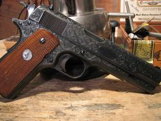 Colt 1911. I like the darker color with engraving!