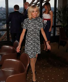 Brigitte looked radiant in her short-sleeve dress, which she paired with black pumps and m...