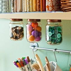 Screw jar lids on the underside of a shelving board or cabinet. Use for storage of buttons, thread or any small objects. Good for the garage or workshop, too, for nuts and bolts, screws, etc.