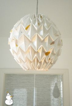 Cotton paper origami lamp shade. Might be worth a diy since there's a tutorial.