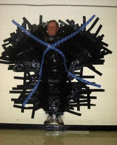 Student fundraisers get to duct-tape principal to wall - South Carroll - Carroll County Times
