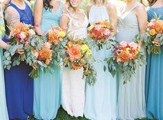 Bridesmaids in mismatched blue dresses