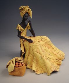 African figure in yellow by British Ceramic Artist, Annie Peaker, Kirk Neuk Studio and Gallery, Cumbria  - love the colour and movement in this piece!