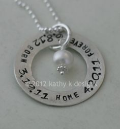 Adoption Necklace Hand Stamped With Dates for Mom on Sterling Silver Ring. $50.00, via Etsy.