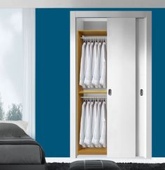 The simplest, cheapest way to get more out of your existing closet is to double up the hang rods. This basic closet upgrade does exactly that and even a bit more. An extra shelf at the middle serves as an additional surface for additional sto