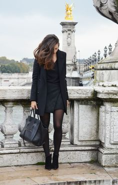 Try pairing a black coat with a black quilted mini skirt to achieve a chic look. Why not introduce black suede booties to the mix for an added touch of style?  Shop this look for $85:  http://lookastic.com/women/looks/ankle-boots-tote-bag-mini-skirt-coat-v-neck-sweater/7606  — Black Suede Ankle Boots  — Black Leather Tote Bag  — Black Quilted Mini Skirt  — Black Coat  — Black V-neck Sweater