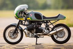 This BMW R1100 cafe racer hails from Flatmaxx Atelier, based in the  south of France. The styling is smooth and almost restrained in profile, anchored by an impeccably executed bone line and tightly balanced cut-offs.