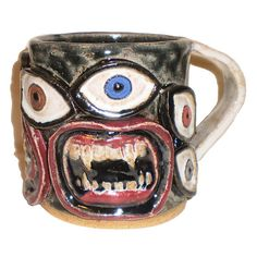Eye Coffee Cup 25  Handbuilt slab mug with pattern of molded eyes and fanged mouths by Aaron Nosheny / Aberrant Ceramics