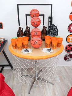 This DIY Basketball Hoop bar table is easy and fun for a March Madness party! Get the details on this and more basketball decor ideas now at fernandmaple.com.