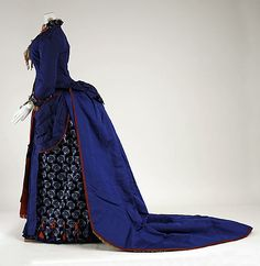 Blue silk dress with red contrast trim (side view, with train released from bustle), by Darlington, Runk & Co., American (Philadelphia), 1880-85.