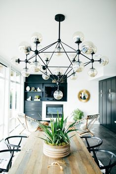 Modern dining space with a eclectic chandelier