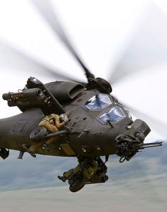 Does anyone know what army these guys are in and WHY their hanging onto the outside of a chopper in the first place!