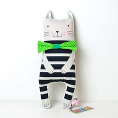 This softie cat is dressed with a fun stripy pattern and a dapper bow tie. He promisses to play a lot with your children and it's a great addition to the nursery room. Original illustration by PinkNounou