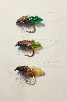 Three colors of Wiggle Caddis Pupa - original tie by Matthew Brown