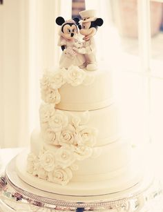 Mickey Mouse & Minnie Mouse wedding cake! This is what my wedding cake looked like. Kept the topper, got rid of the husband.