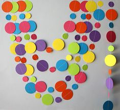 Rainbow paper garland, Birthday decorations, Birthday party decor, Circle paper garland, Nursery decor, First birthday decor, Baby shower    The garland you see in the pictures are 1 and 2 iinches.    Looks great on or around your table, hanging in the wall, the door, the window, the shelves... or hung them with tape from the ceiling! With the required security cautions you can hang them from lamps and make a beautiful circles cascade.    An inexpensive way to decorate!      IF YOU WANT THIS…