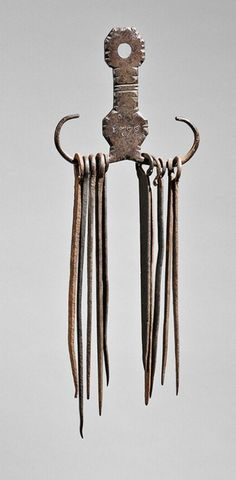"""Skinner Auction: 2744M  8/9/14. Lot: 79. Estimate $1,500-2,500. Sold for:$1,968.  Description:  Wrought Iron Skewer Holder and Skewers, America, late 18th/early 19th century, the double hexagonal lollipop form with cut-edge embellishment and date """"1798,"""" with ten skewers, ht. 4 1/2, wd. 4 1/2 in.   Provenance: The Howard Roth Collection."""