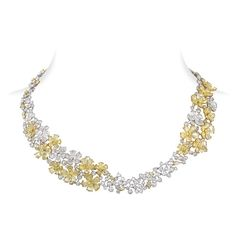 Jasmine necklace that captures the beauty of a jasmine flower and its natural asymmetry is adorned with diamond-cut briolette and Jasmine Cut to form a corolla. More than 50 carats of diamonds are set in 18K white gold; Copyright Mirav Modi