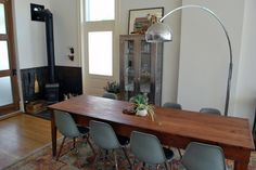 Love the dining room table and chairs as well as the medical cabinet on the wall via Apartment Therapy.