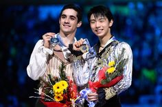 Javier Fernandez (L) of Spain and Yuzuru Hanyu of Japan pose for the media during the medals ceremony during day three of the ISU Grand Prix of Figure Skating Final 2014/2015 at Barcelona International Convention Centre on December 13, 2014 in Barcelona, Spain.