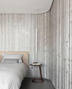 Graue Holzwand mit stylischen runden Ecken                              …