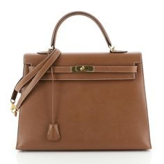 The Hermès Kelly Handbag Gold Courchevel with Gold Hardware 35 Brown Leather Tote is a top 10 member favorite on Tradesy. Gold Handbags, Hermes Handbags, Brown Interior, Leather Interior, Birkin, Hermes Kelly, Kelly Brown, Brown Leather Totes, Gold Hardware