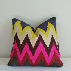Beautiful pillow cover in a vibrant Schumacher Adras Ikat print cotton. Add a modern touch to your decor! All of my pillows are handcrafted with careful attention to detail: * Inside seams are serged to prevent fraying * Backed in a coordinating solid * Invisible zipper closure This sale is for ONE pillow cover and does not include the pillow insert. Please let us know if you need a particular size that is not listed.