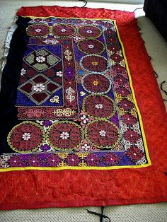 'tushiiz' fabric piece placed above sleeping area like a headboard in yurt from Kazahstan