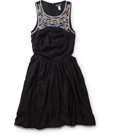 Cut from an ultra soft and lightweight rayon material for comfort, this halter dress is adorned with contrast embroidered detailing along the neckline and bottom hem with cut-out sides