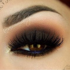 Heavy dark smokey eye with purple waterline I like the gold in the inner corner.