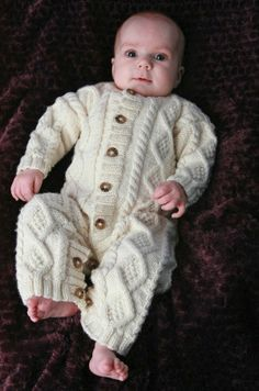 Cozy Cabled Baby Onesie | AllFreeKnitting.com.  Made one almost exactly like this for my youngest child 11 years ago.  It won 2nd place at the fair.