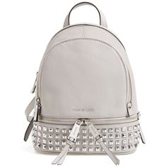 MICHAEL Michael Kors 'Extra Small Rhea Zip' Studded Backpack ($298) ❤ liked on Polyvore featuring bags, backpacks, pearl grey, grey bag, michael kors backpack, grey backpack, rucksack bag and gray bag