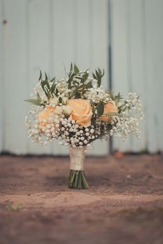 The bridal bouquet - gypsophila, ruskus, and white and peach roses