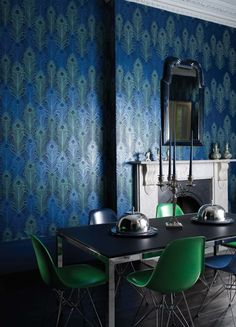 Peacock Wallpaper A signature wallpaper design by Matthew Williamson featuring peacock feathers in metallic jade and cobalt with tiny reflective beads on a midnight blue.
