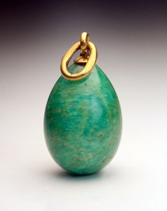 A Gold Mounted Carved Amazonite Egg Pendant  by Peter Carl Faberge  The egg was made in St. Petersburg between 1899 and 1904.  The gold suspension ring is marked with 56 zolotnik old Russian gold standard (14K) with assayer's initials of Yakov Liapunov,   and maker's initials 'A N' for Faberge's workmaster Anders Nevalainen.  Height without the ring 20 mm (3/4 in.)