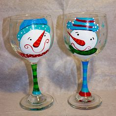 This listing is for 2 wine glasses, hand painted with festive Mr. & Mrs. Snowmen designs, his and hers. What a cute way to have a sip for the holidays, use for decoration, or for gift giving. Each glass is hand painted and cured to keep the painting durable.  These glasses must be hand washed. Please do not put them in the dishwasher.  Glasses come packaged in bubble wrap and sturdy packaging. Gift wrapping available upon request. Custom listings and quantities available upon request. For...