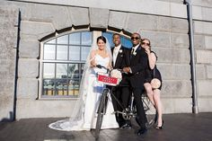 Use props for your bridal party photo.  This bike was from the hotel where the reception was.  Picking objects that tie into details of your wedding day are a great idea. Brittany and Jamahl's Wedding at the Liberty Hotel in Boston » Fuccis Photos of Boston–Something Blue Blog | Boston Wedding Photographer Image by Vail Fucci