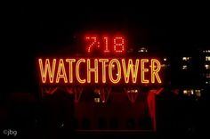 Neon-Glowing Watchtower Sign - Columbia Heights, Brooklyn
