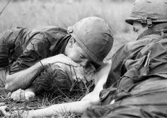 Medic James E. Callahan of Pittsfield, Mass., gives mouth-to-mouth resuscitation to a dying soldier in war zone D, about 50 miles northeast of Saigon, June 17, 1967. Thirty-one men of the 1st Infantry Division were reported killed in the guerrilla ambush, with more than 100 wounded.
