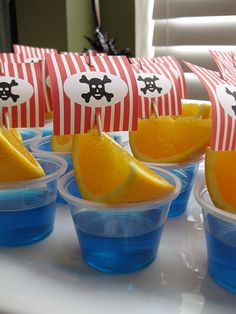 Oranges + shot cups of blue jello + toothpick flags = pirate ships.